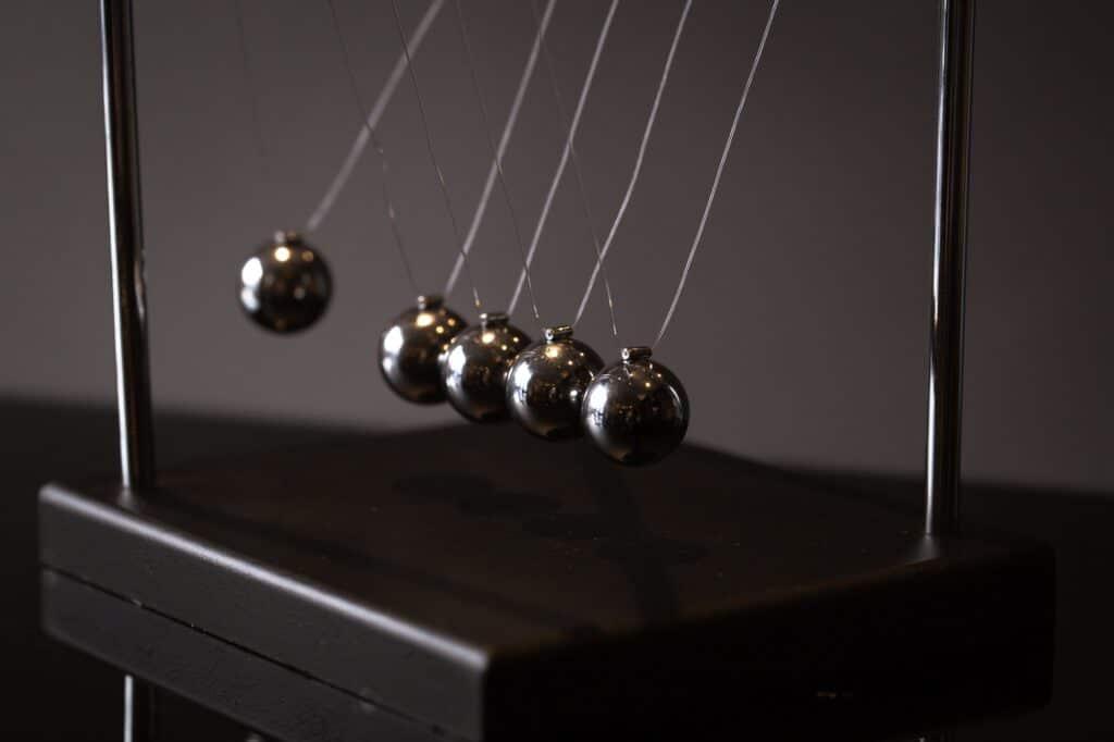 Newton cradle representing momentum